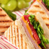 Summer picnic club sandwich ham and cheese in a row